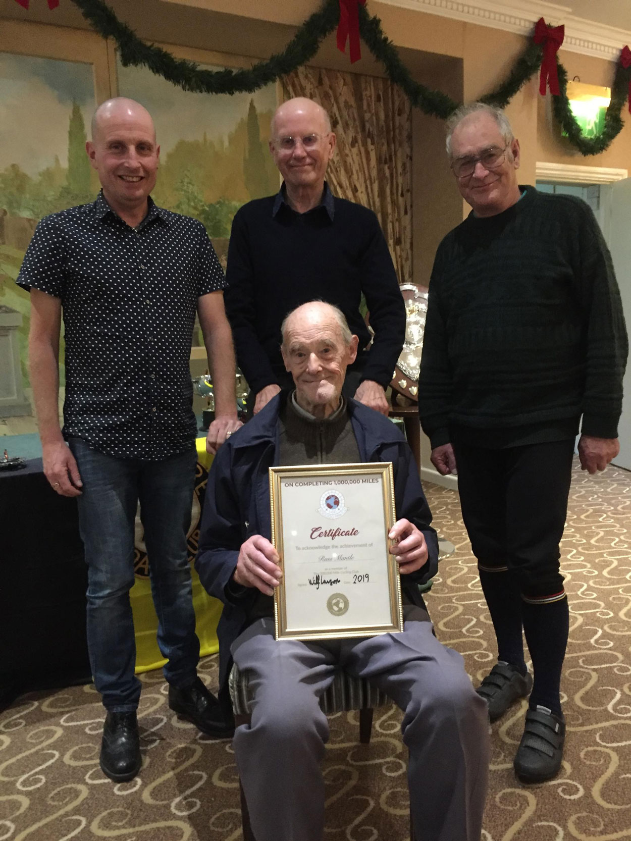 Russ Mantle and his 1,000,000 Mile certificate with members Paul Whitehead, Derek Hayday, and Malcolm Waters